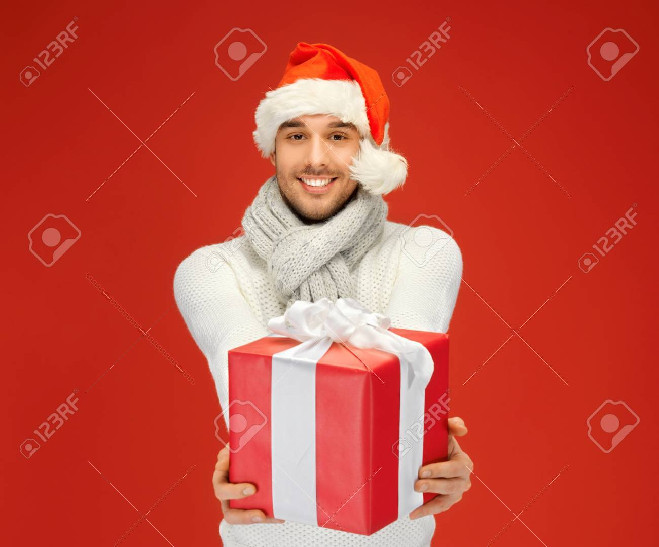 bright picture of handsome man in christmas hat Stock Photo - 16216101