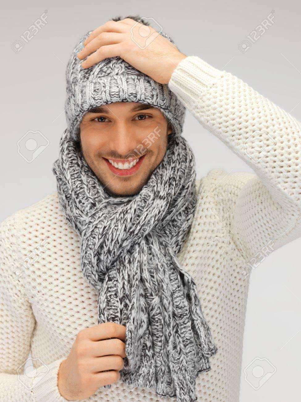 picture of handsome man in warm sweater, hat and scarf Stock Photo - 16216124