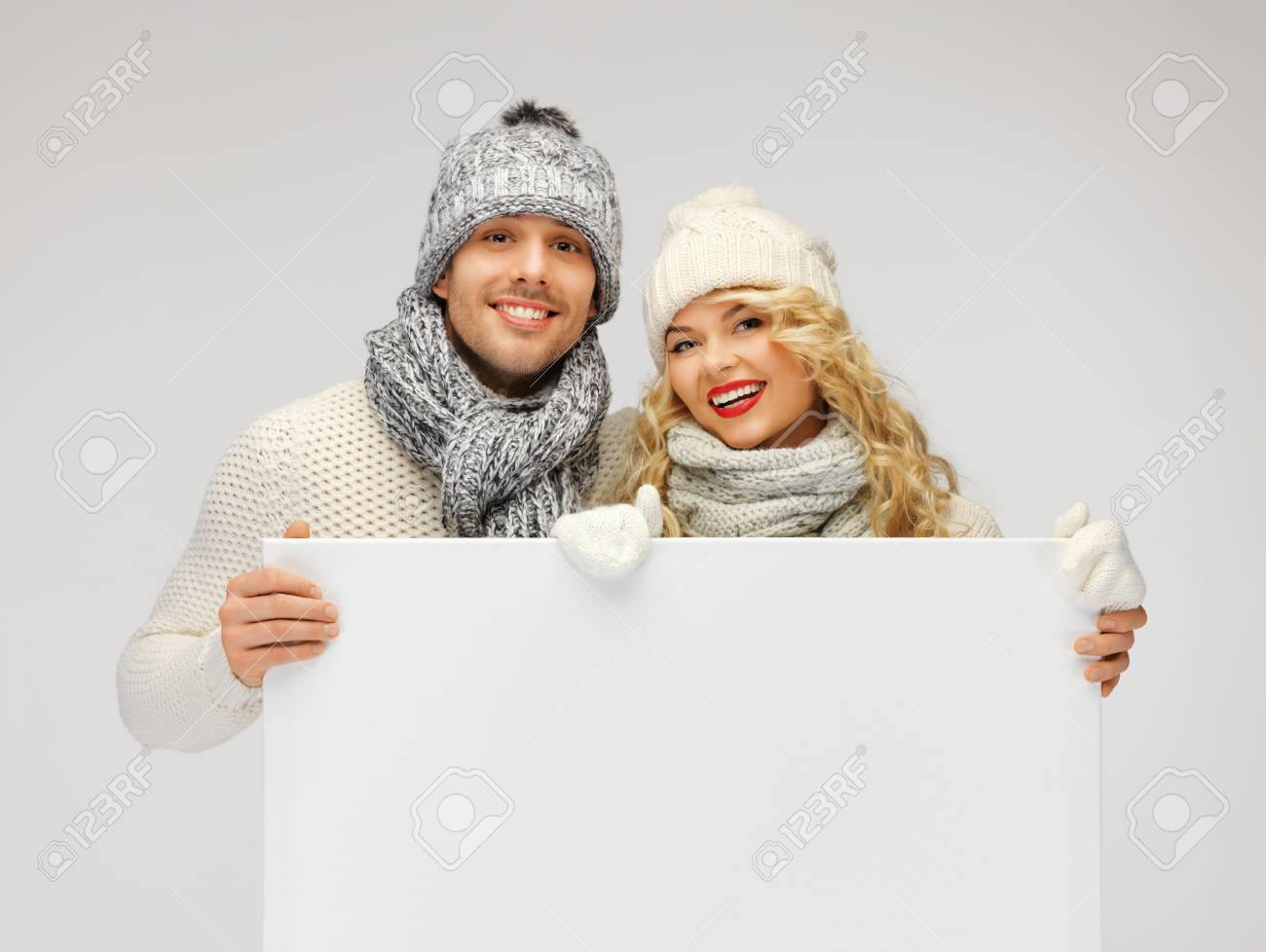 picture of family couple in a winter clothes holding blank board Stock Photo - 16300274