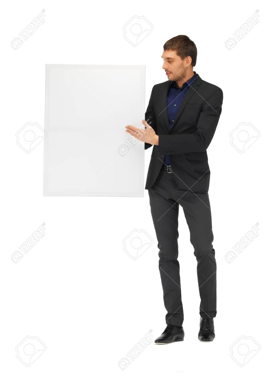 picture of handsome man in suit with a blank board Stock Photo - 16411141