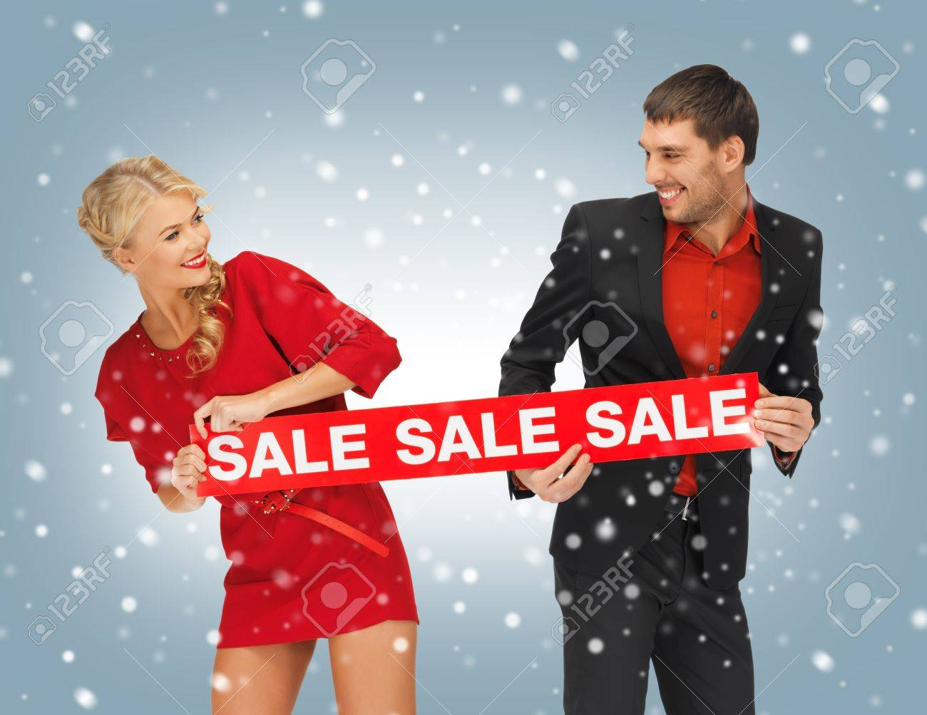 bright picture of man and woman with sale sign Stock Photo - 16471894