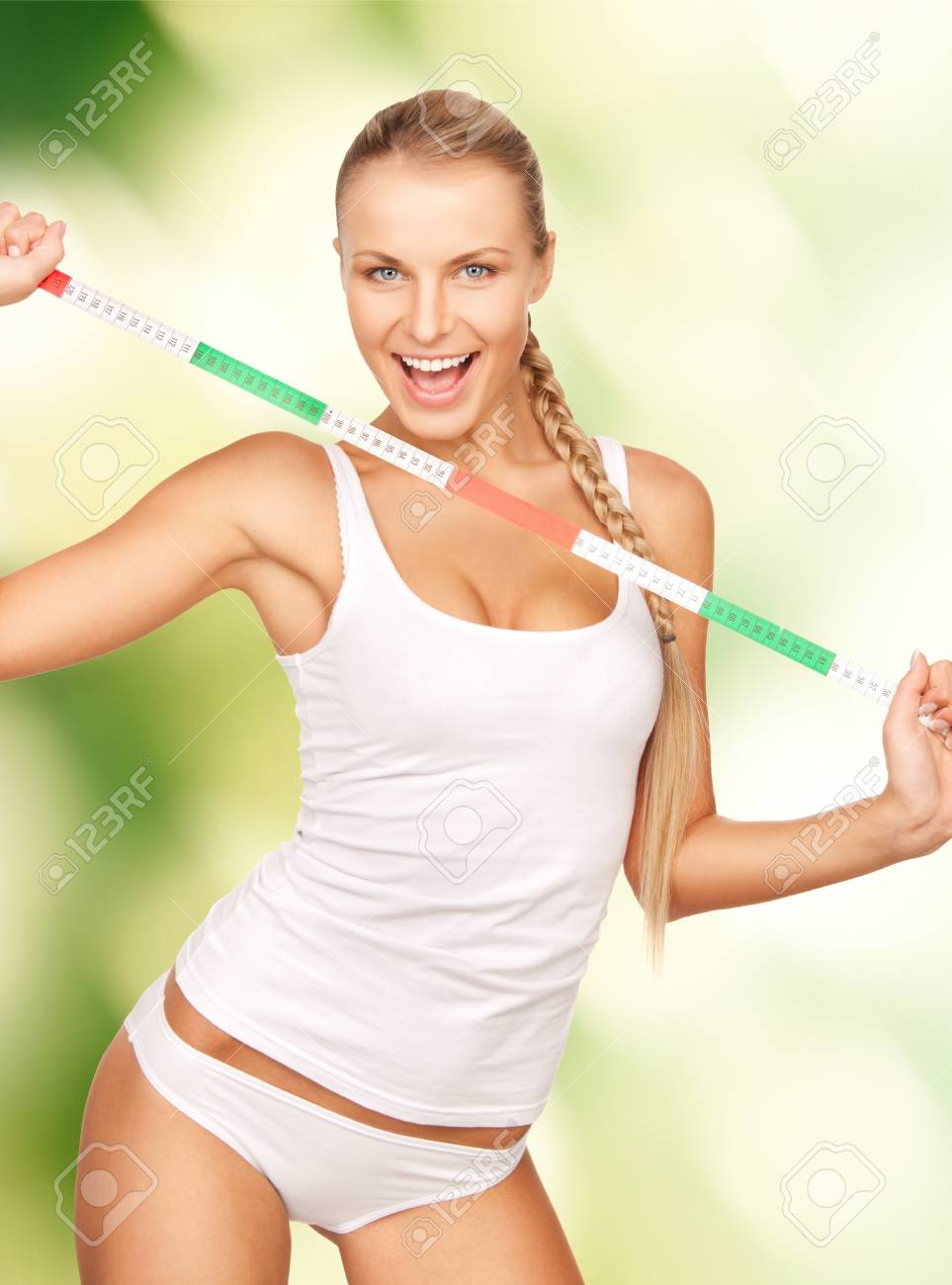 picture of young beautiful woman with measure tape Stock Photo - 16547734