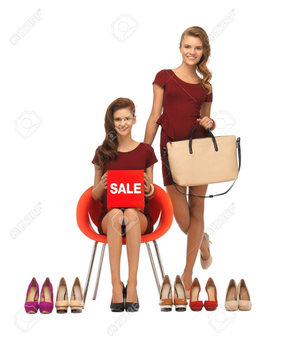 picture of teenage girls in red dresses with shoes, bag and sale sign Stock Photo - 16734232