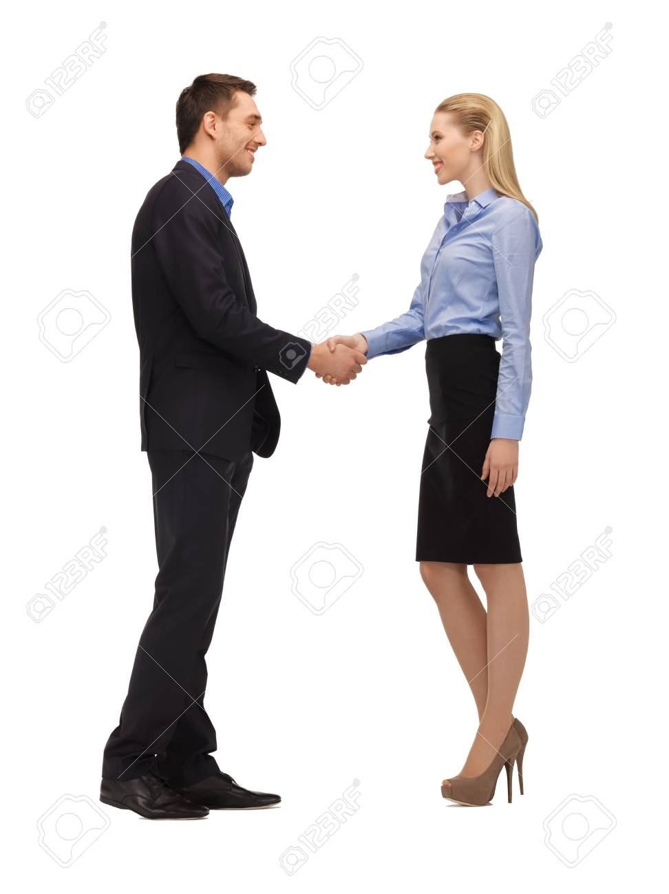 bright picture of man and woman shaking their hands Stock Photo - 16909501