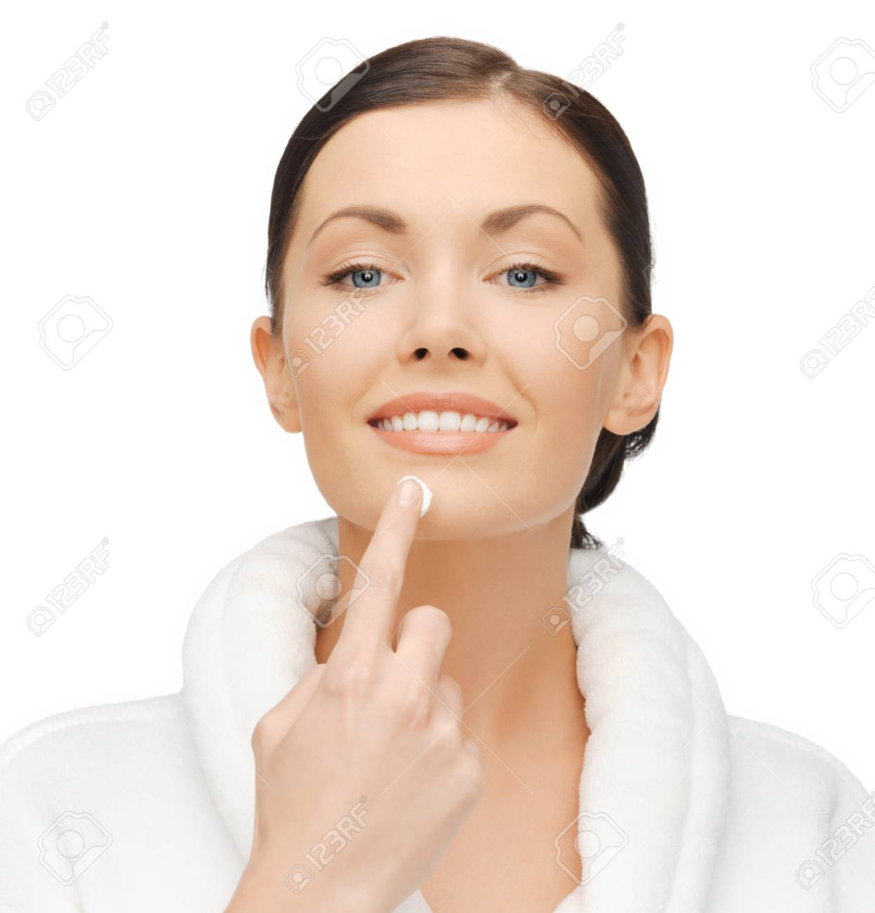 picture of woman in bathrobe applying cream Stock Photo - 17370300