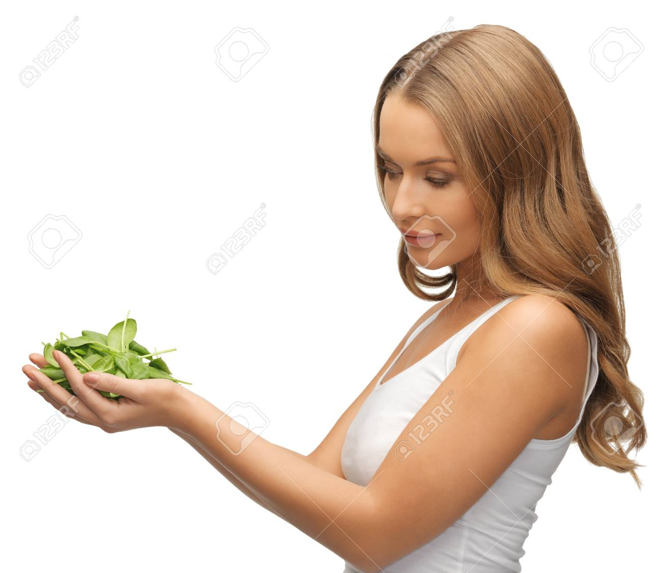 bright picture of woman with spinach leaves on palms Stock Photo - 17370307