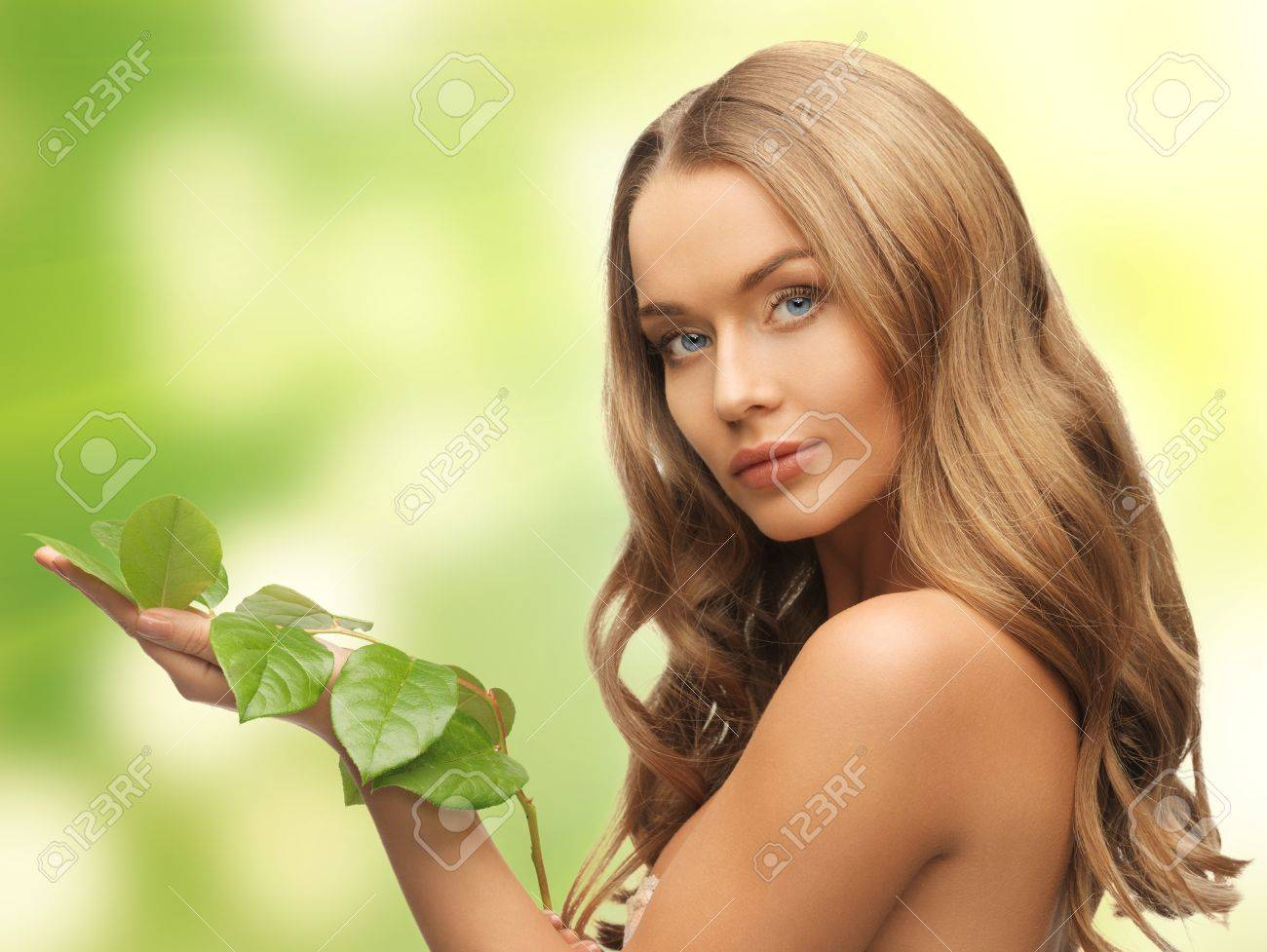 picture of woman with green leaf over white Stock Photo - 17501653