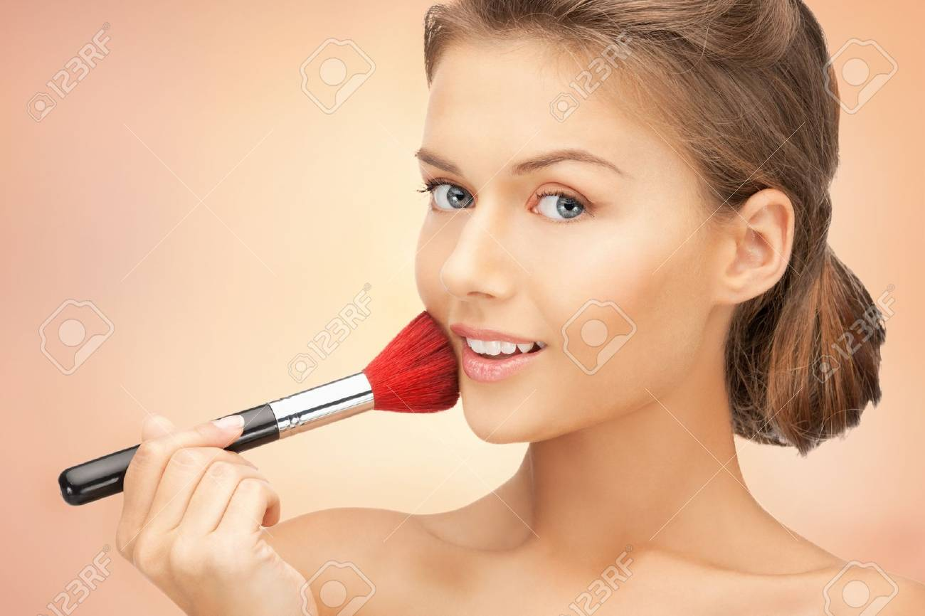 bright closeup portrait picture of beautiful woman with brush Stock Photo - 17480018