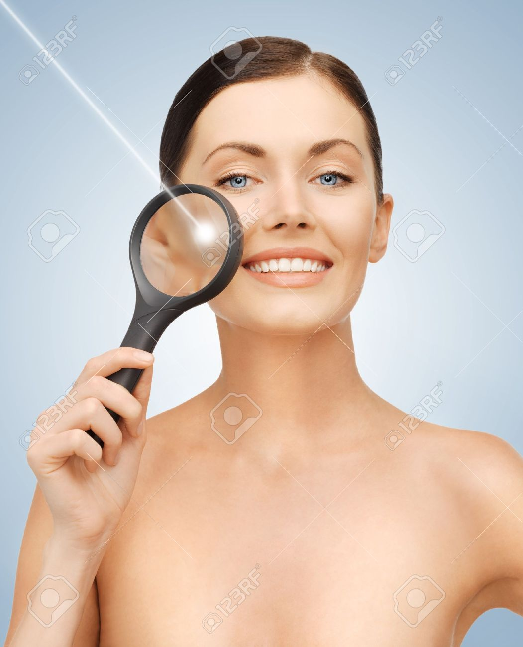 bright picture of beautiful woman with magnifying glass and laser Stock Photo - 17602508