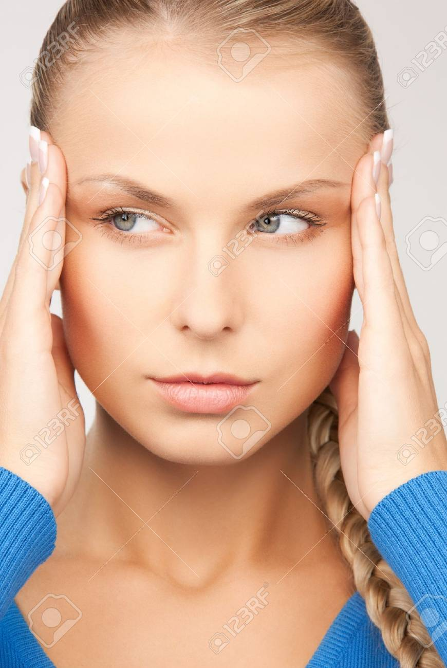 unhappy woman holding her head with hands Stock Photo - 17796830