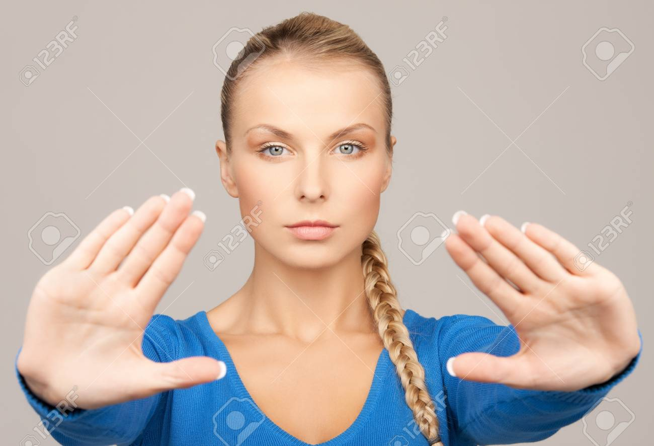 bright picture of young woman making stop gesture Stock Photo - 18004923