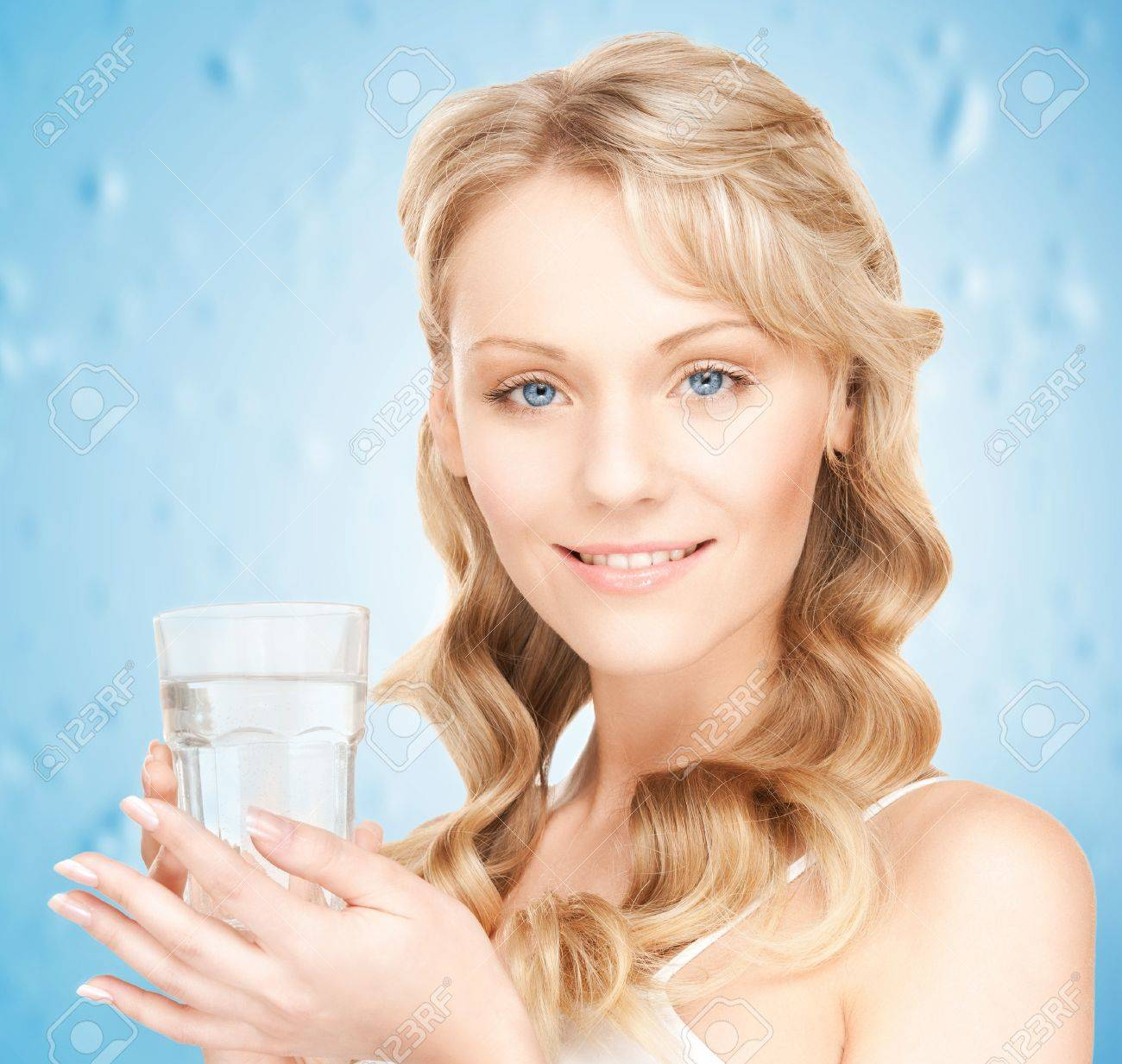 closeup picture of woman holding glass of water Stock Photo - 18126772