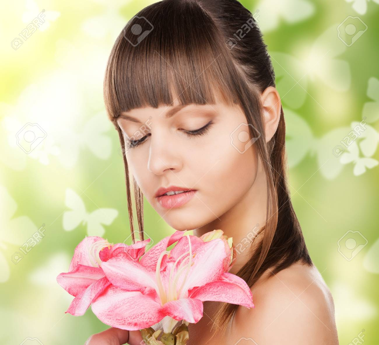 picture of beautiful woman with lily flower and butterflies Stock Photo - 18299753