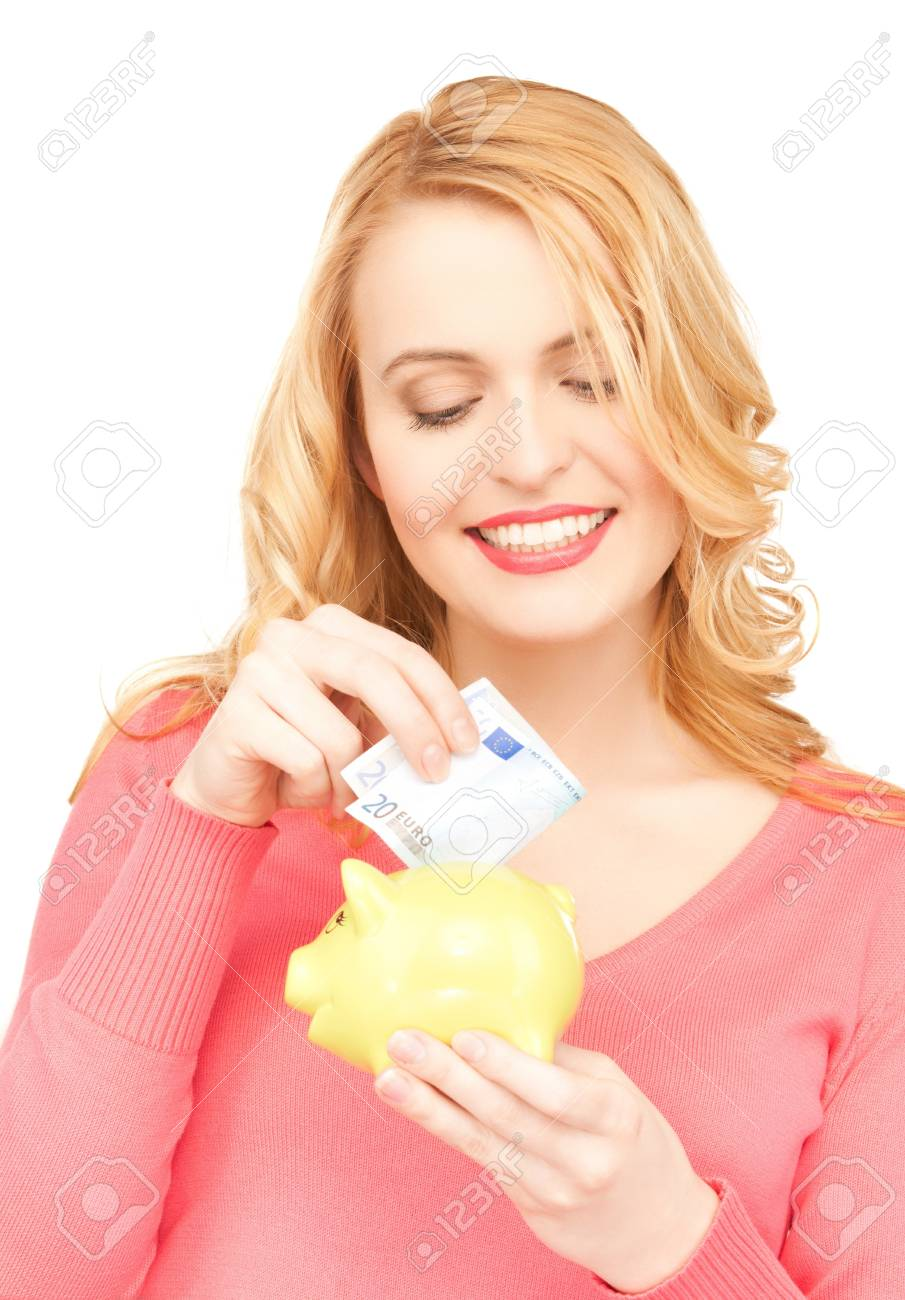 picture of lovely woman with piggy bank and cash money Stock Photo - 18299813
