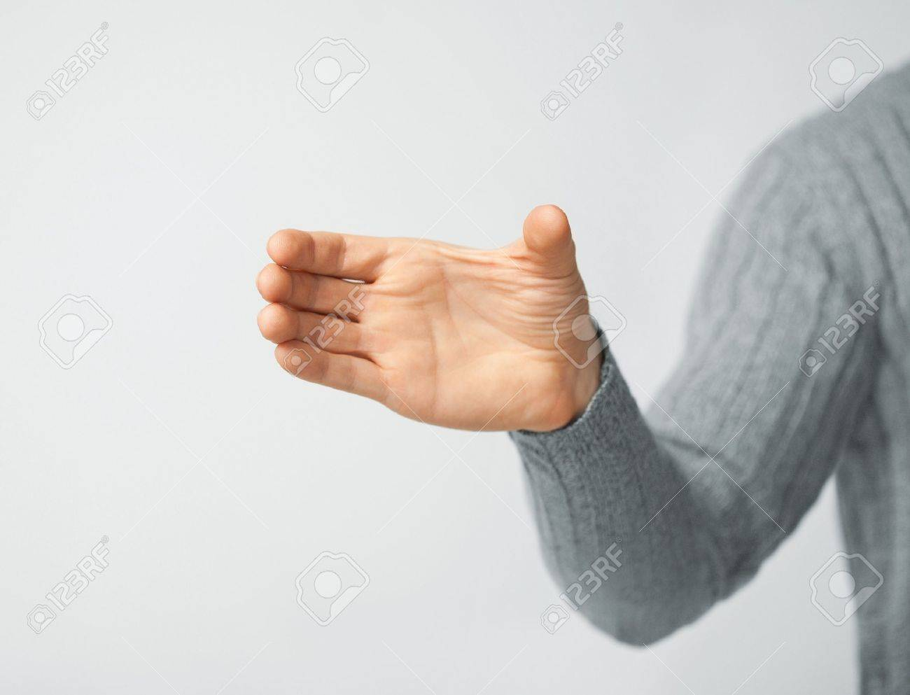 bright picture of man holding imaginary object Stock Photo - 18409752