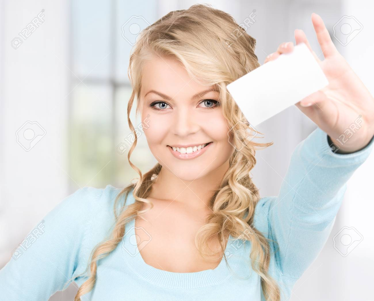 happy girl with business card in office Stock Photo - 18423861