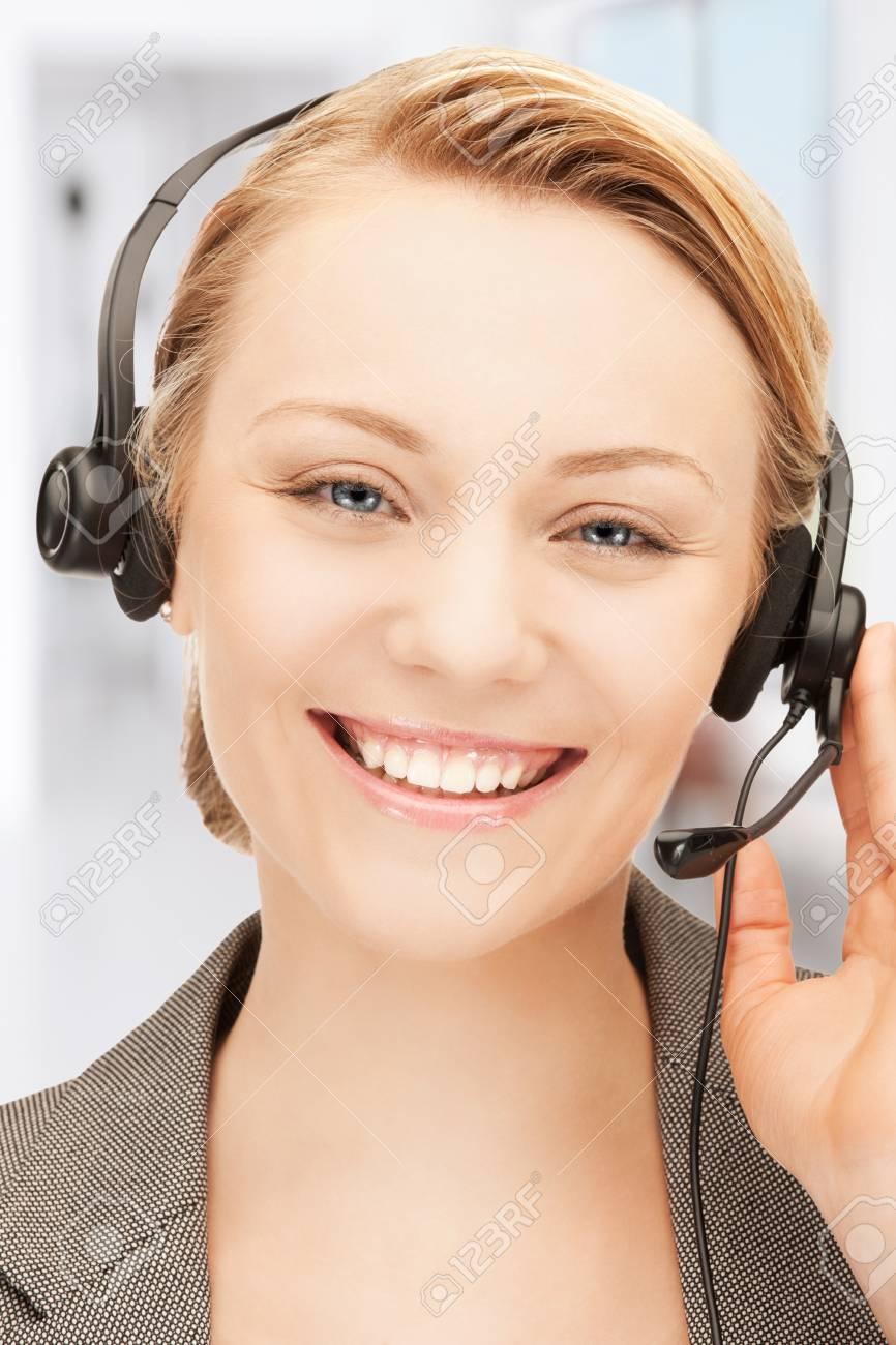 bright picture of friendly female helpline operator Stock Photo - 18423912