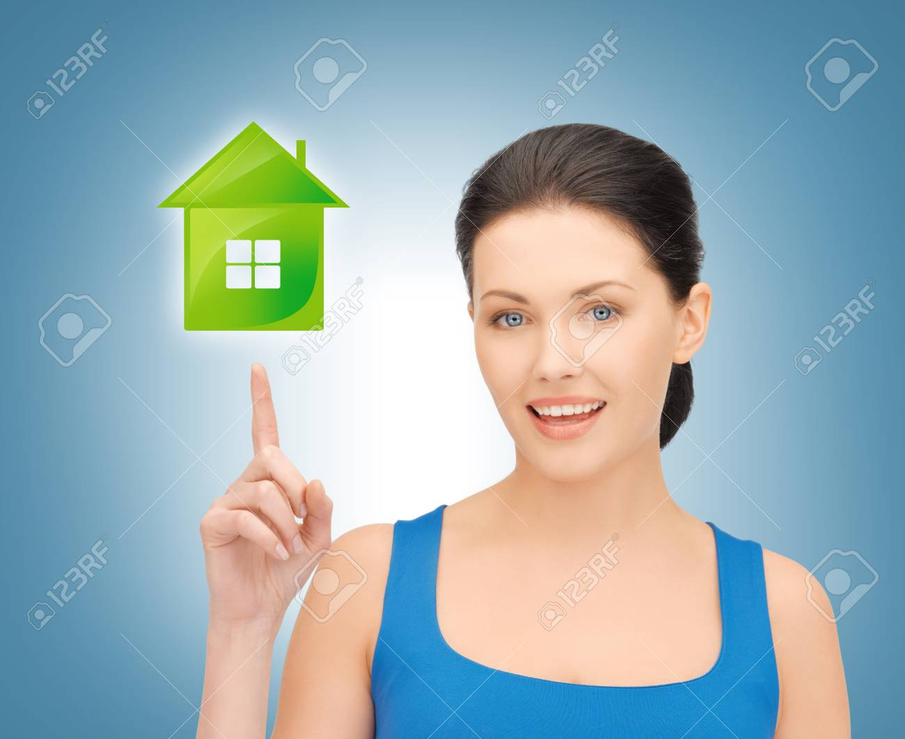 picture of beautiful woman pointing her finger on green house Stock Photo - 18530487