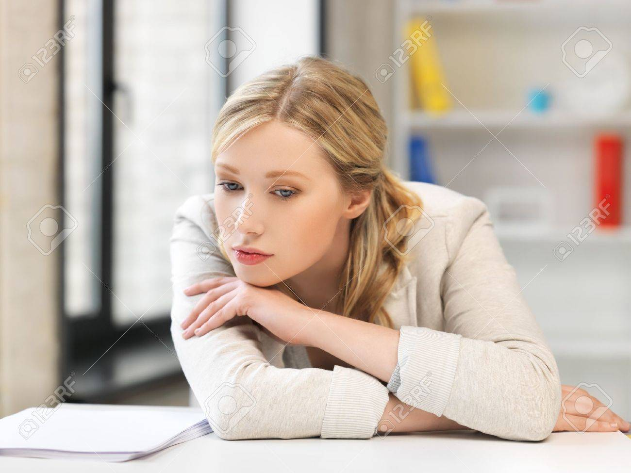 indoor picture of bored and tired woman behind the table Stock Photo - 18655026