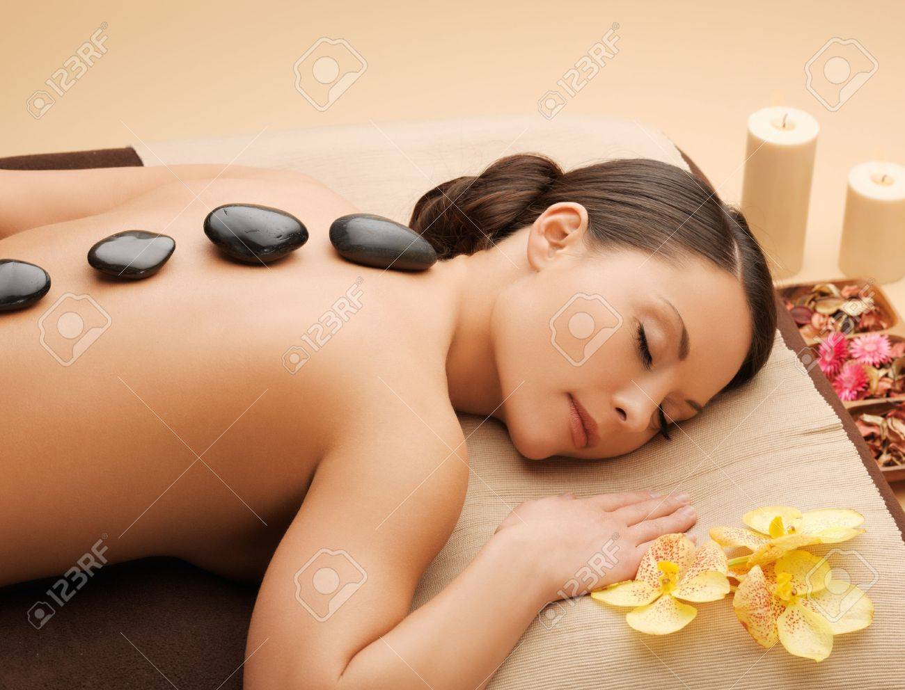 picture of woman in spa salon with hot stones Stock Photo - 18803874