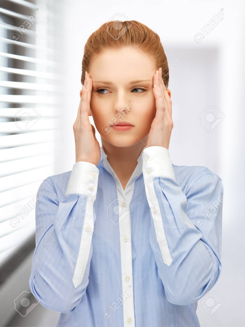 bright picture of unhappy woman in office Stock Photo - 19229988