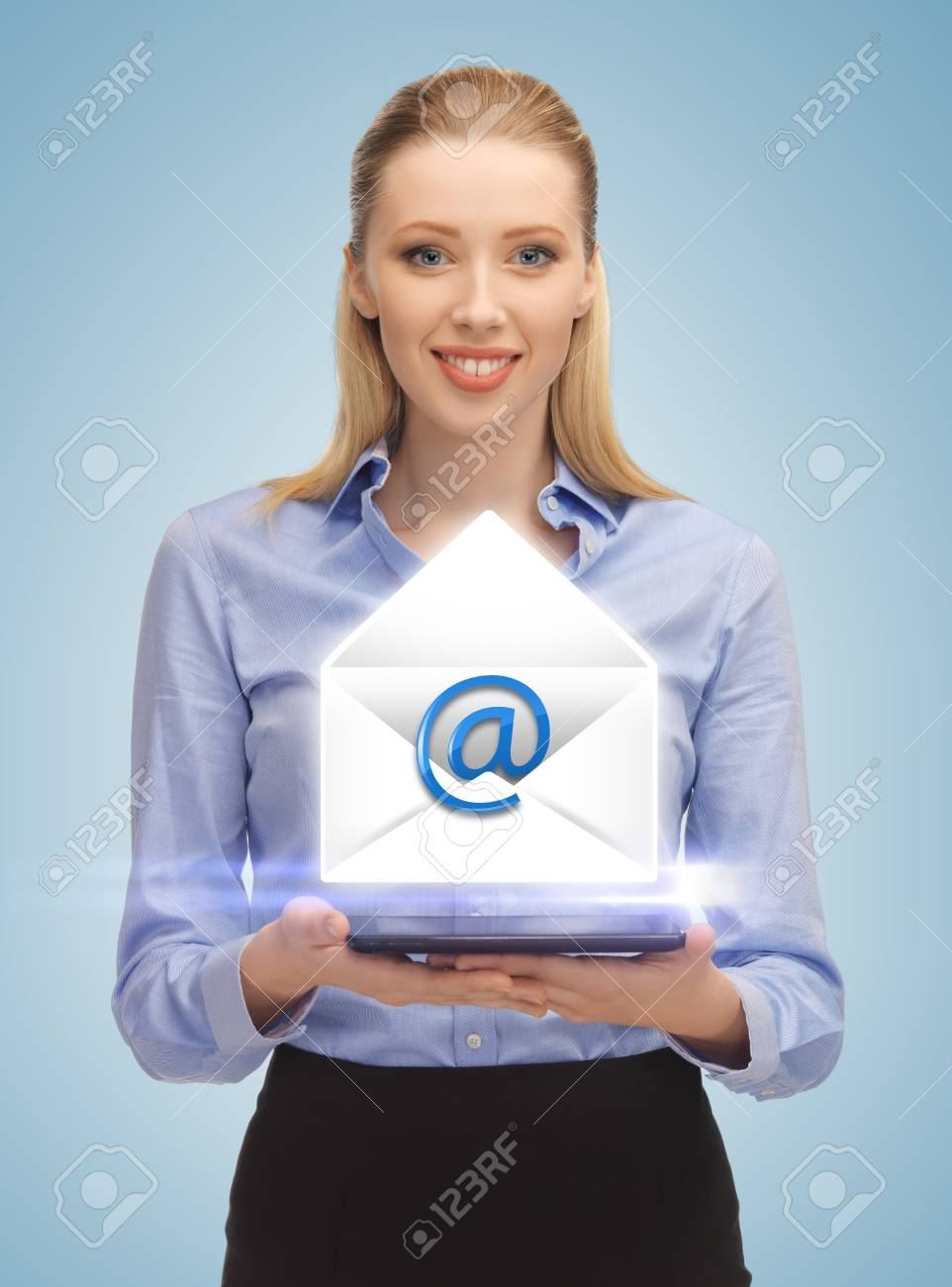 picture of smiling woman showing virtual envelope Stock Photo - 19347226