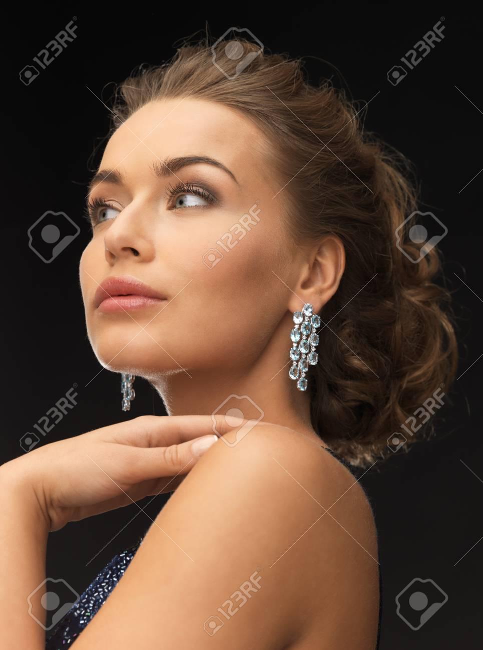 beautiful woman in evening dress wearing diamond earrings Stock Photo - 19347187