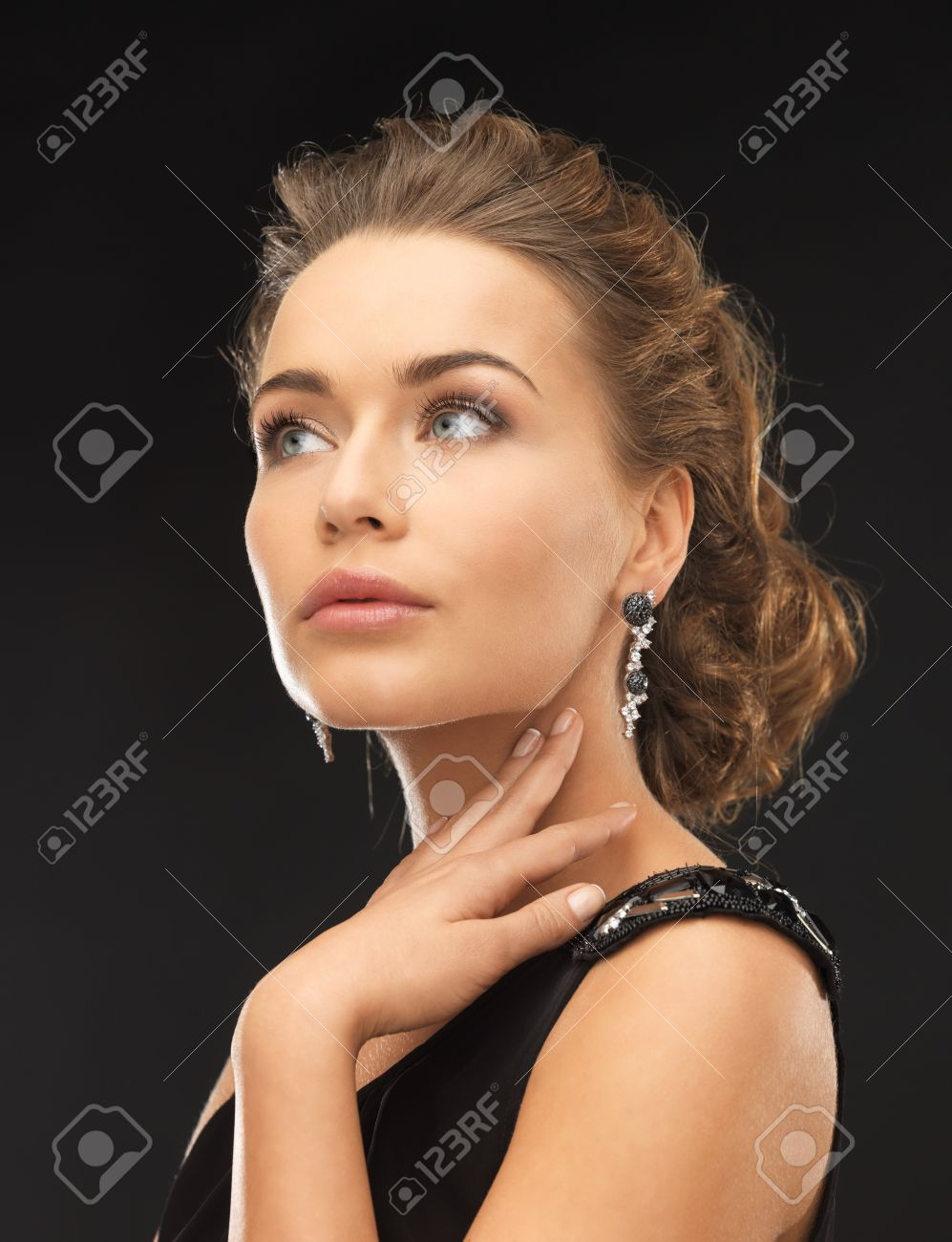 beautiful woman in evening dress wearing diamond earrings Stock Photo - 19347206