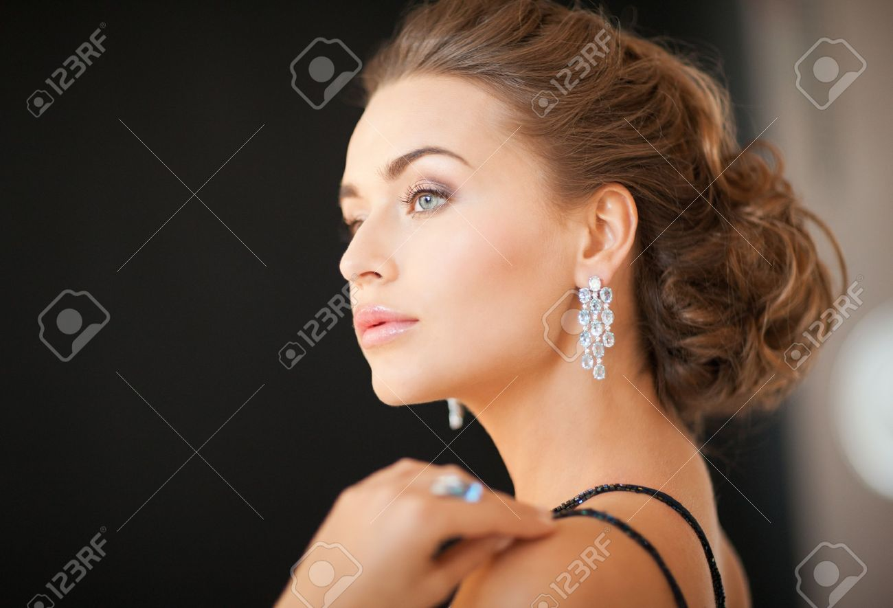 beautiful woman in evening dress wearing diamond earrings Stock Photo - 19347257