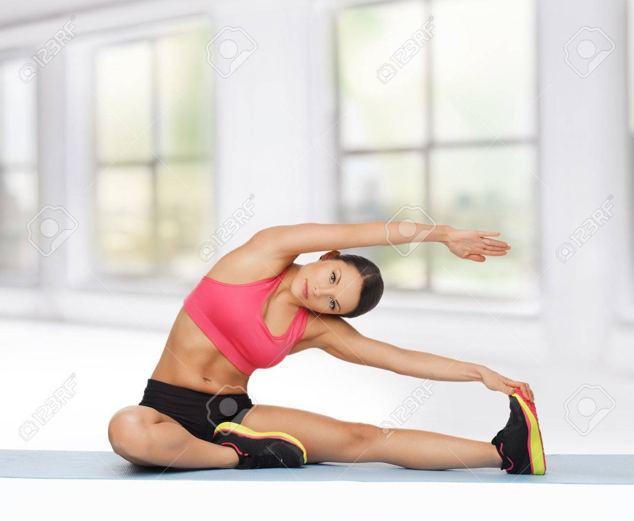 beautiful sporty woman doing exercise on the floor Stock Photo - 19483691