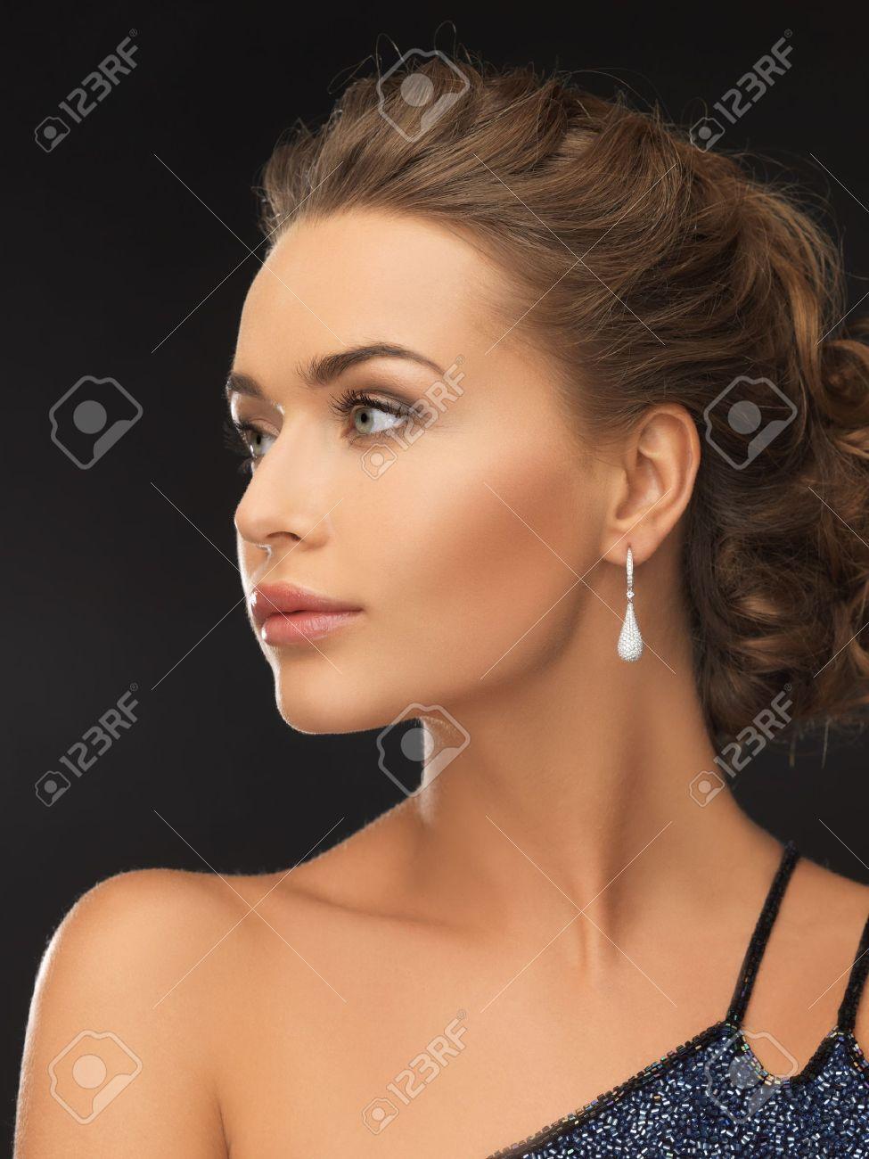 beautiful woman in evening dress wearing diamond earrings Stock Photo - 19484045