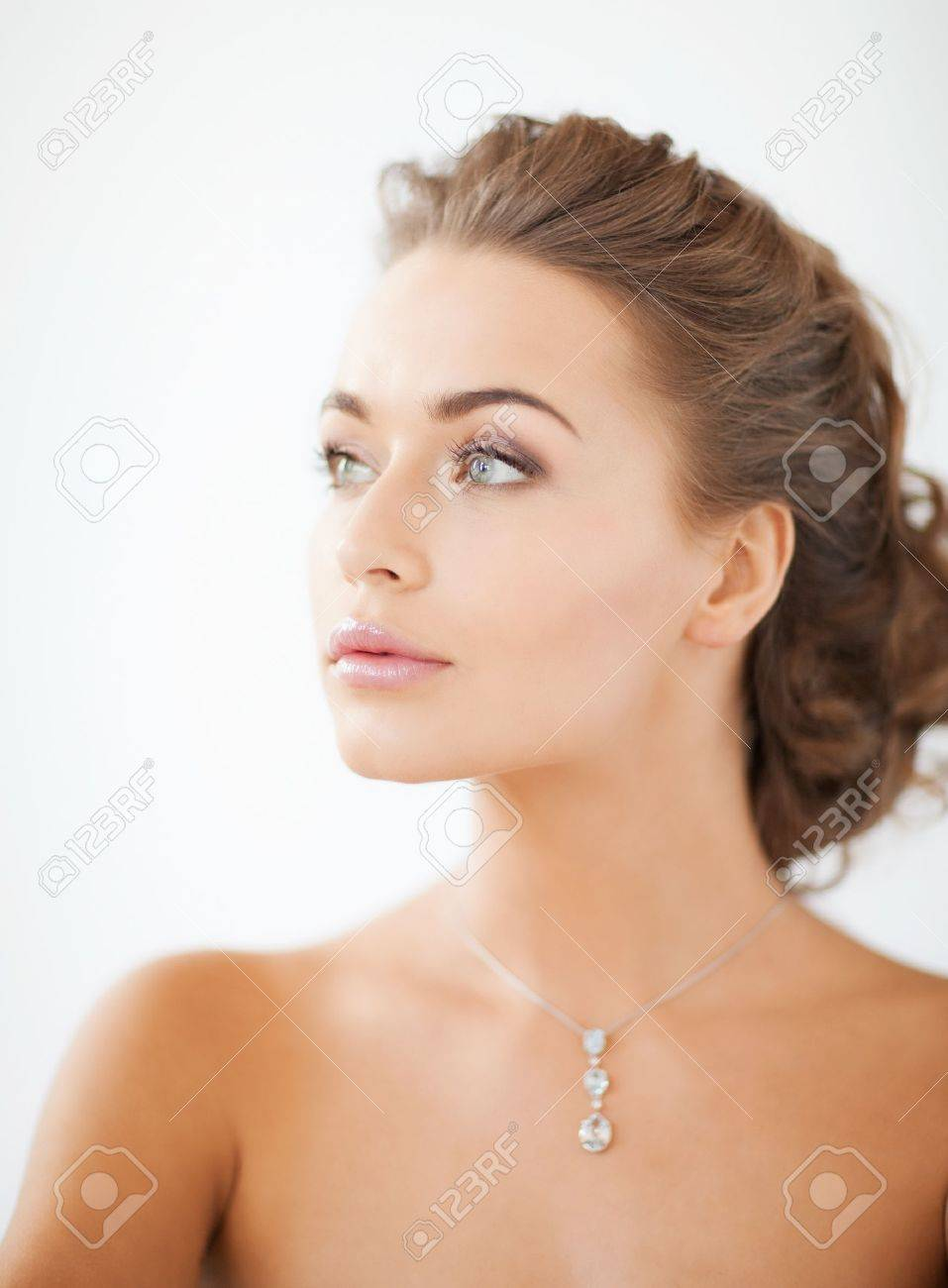 close up of beautiful woman wearing shiny diamond necklace Stock Photo - 19483975