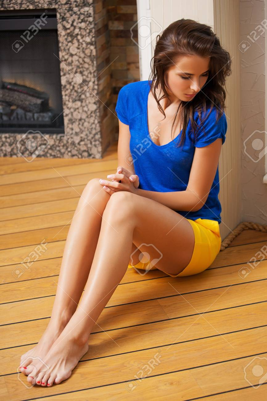 picture of thinking woman sitting on the floor Stock Photo - 19484035