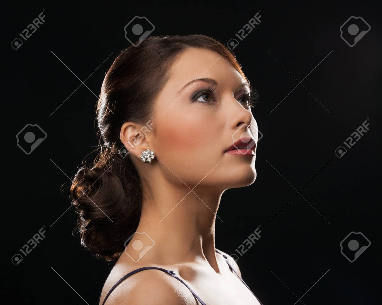 beautiful woman in evening dress wearing diamond earrings Stock Photo - 19563075
