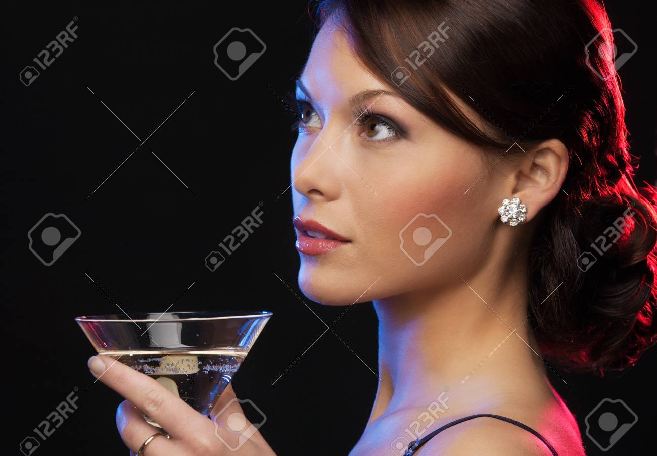 beautiful woman in evening dress with cocktail Stock Photo - 19563092