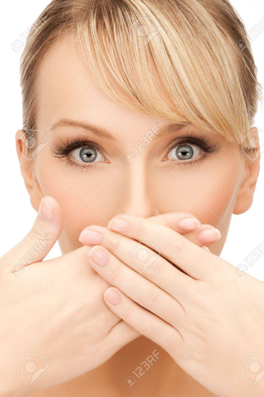 face of beautiful woman covering her mouth Stock Photo - 19730353