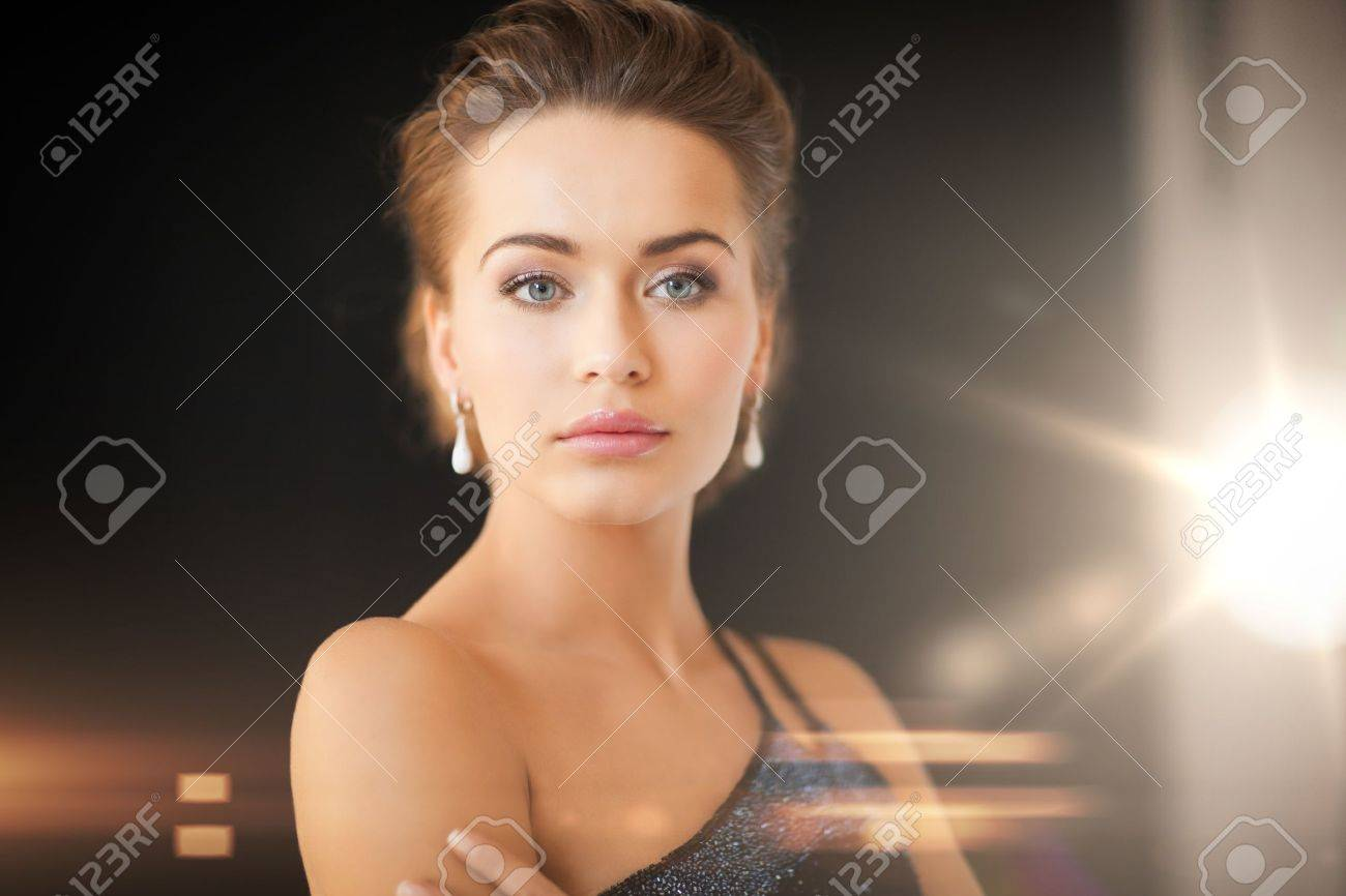 woman image stock stud rings and earrings of online young ear with girl