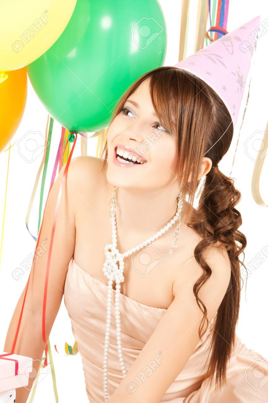 happy girl with colorful balloons in party cap Stock Photo - 19857284