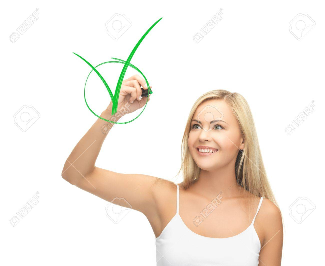 smiling woman in white shirt drawing green checkmark Stock Photo - 19944005