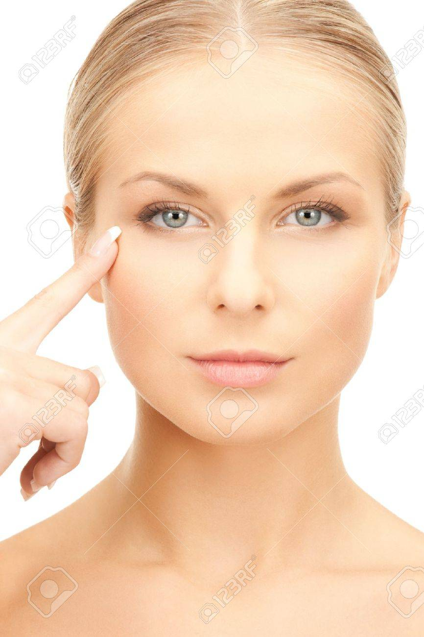 face of beautiful woman pointing at her eye area Stock Photo - 20074783