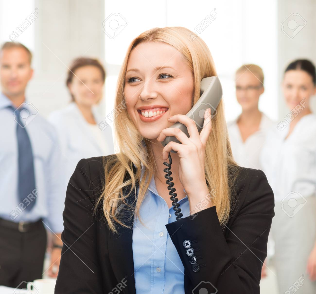 bright picture of smiling woman with phone in office Stock Photo - 20595445
