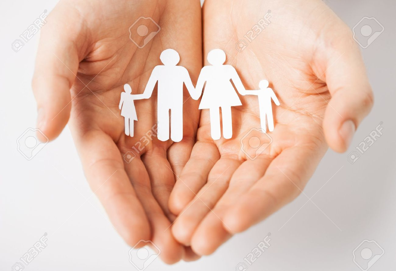 man hands showing family of paper men Stock Photo - 20772705
