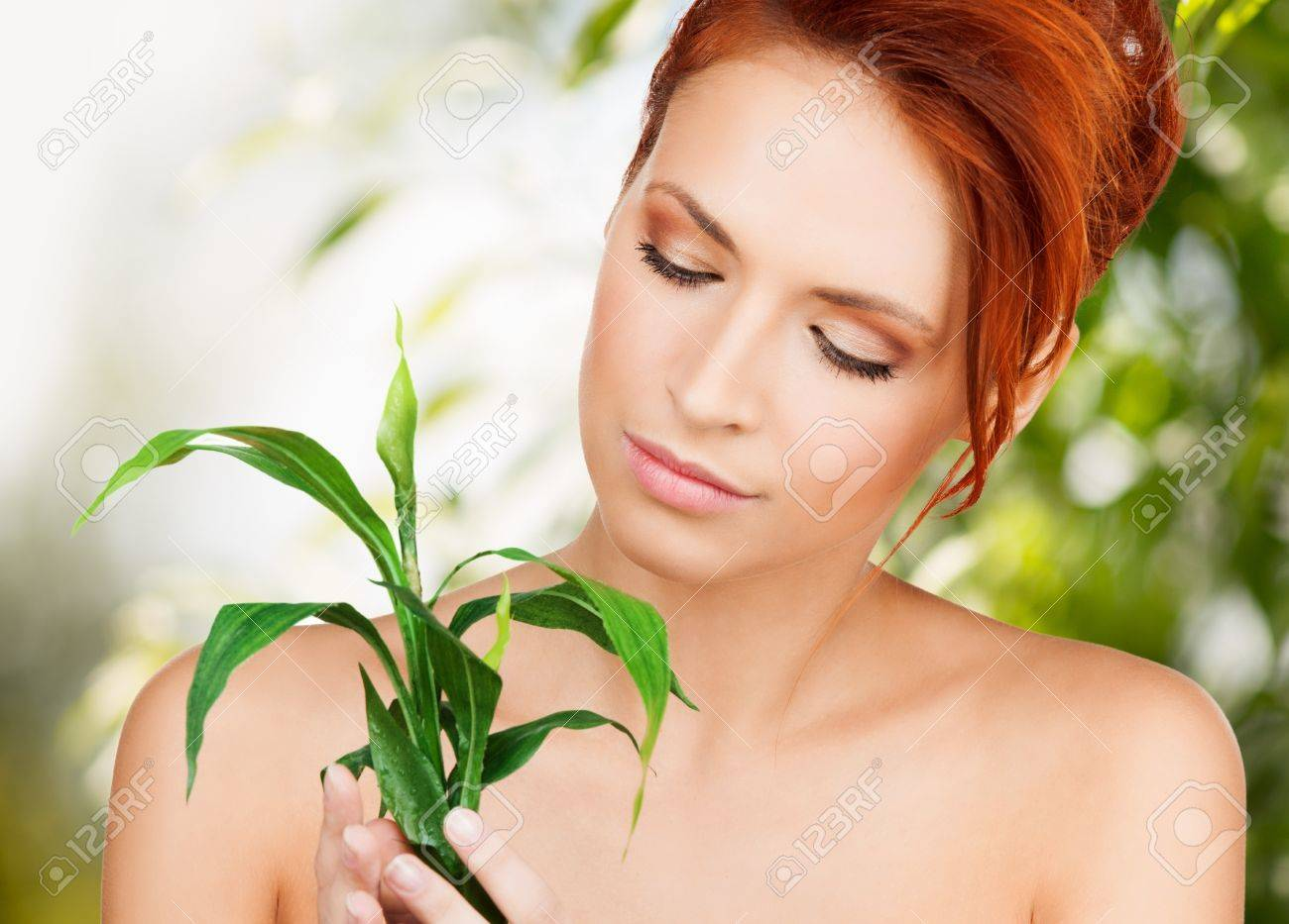beauty and eco cosmetology concept - beautiful woman on nature with green sprout Stock Photo - 20859542