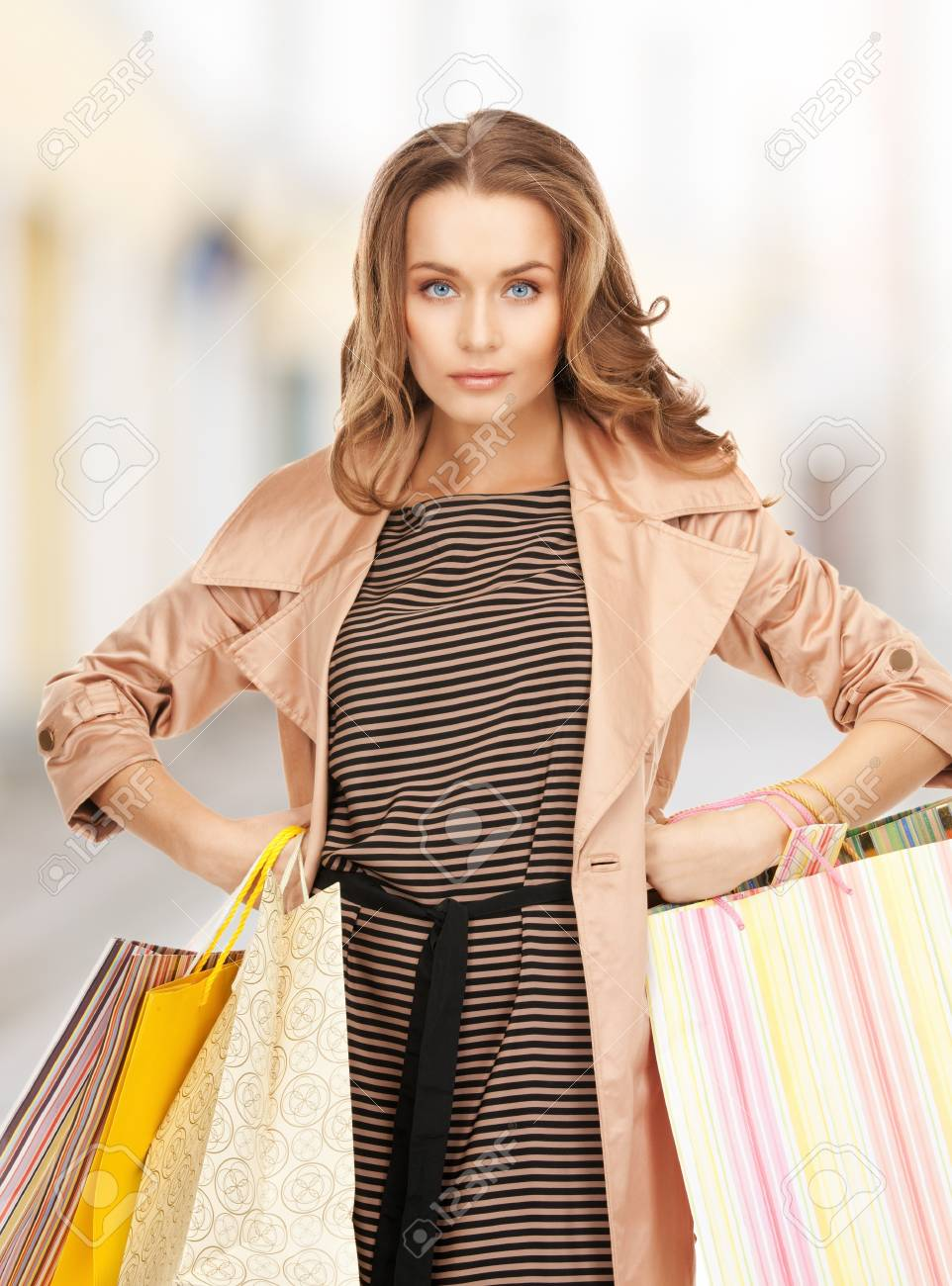 shopping and tourism concept - beautiful woman with shopping bags in ctiy Stock Photo - 21034305