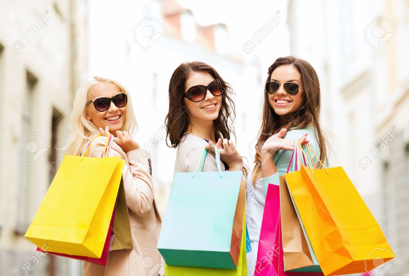 Shopping And Tourism Concept - Beautiful Girls With Shopping ...