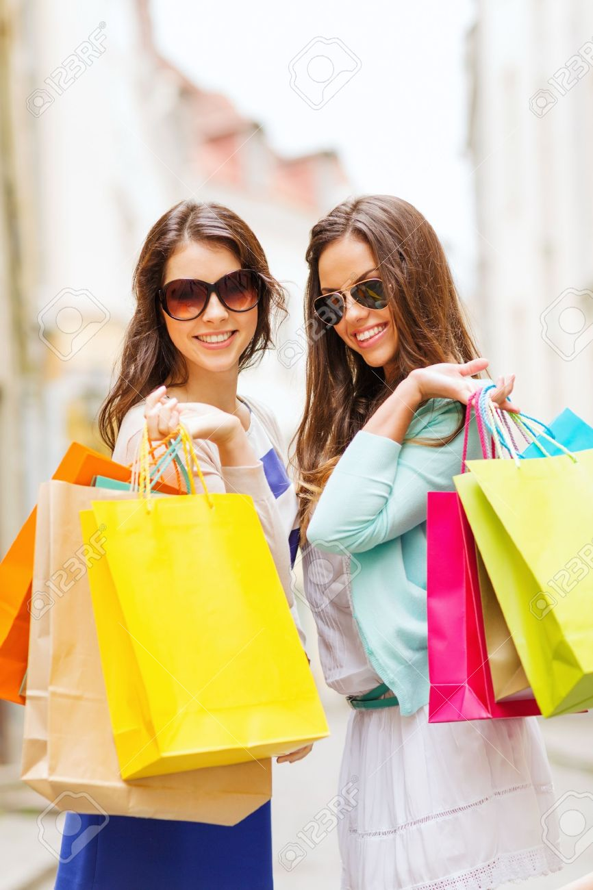 shopping and tourism concept beautiful girls with shopping