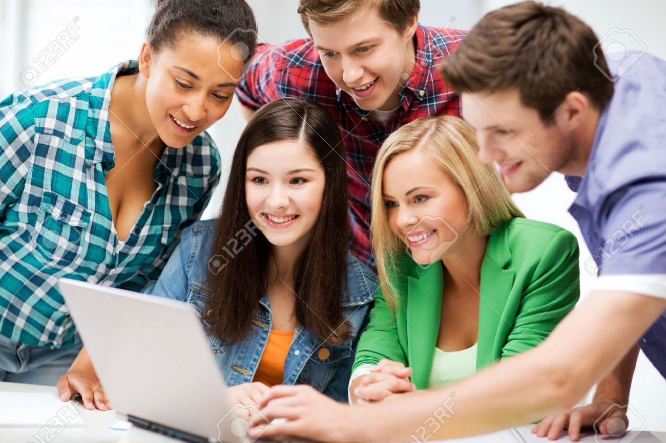 education and internet - smiling students looking at tablet pc in lecture at school Stock Photo - 21034798