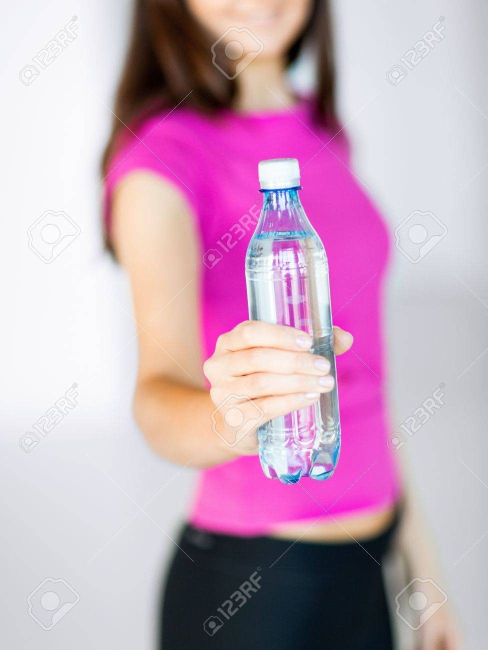 sport and diet concept - sporty woman with bottle of water Stock Photo - 21219061