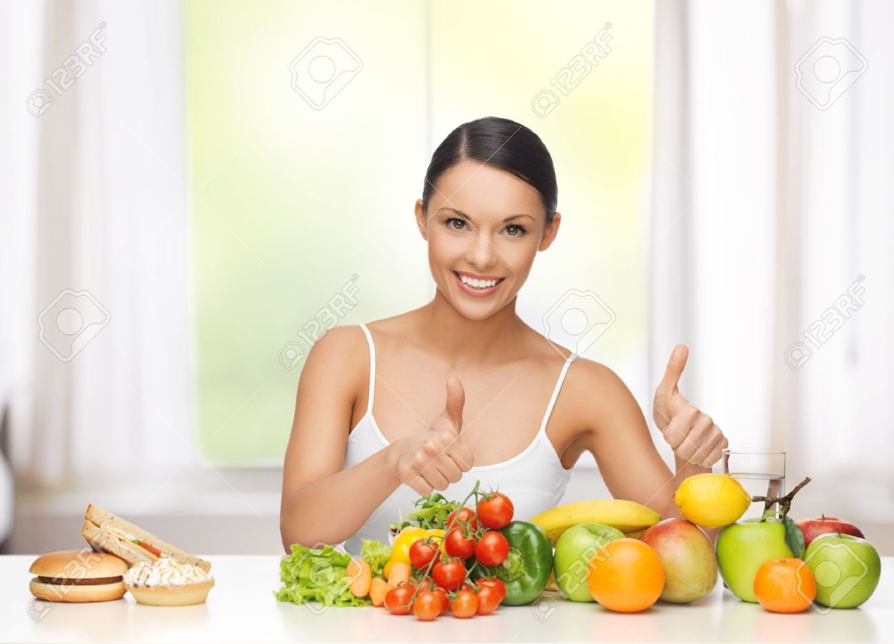 healthy and junk food concept - woman with fruits rejecting hamburger and cake Stock Photo - 21680047