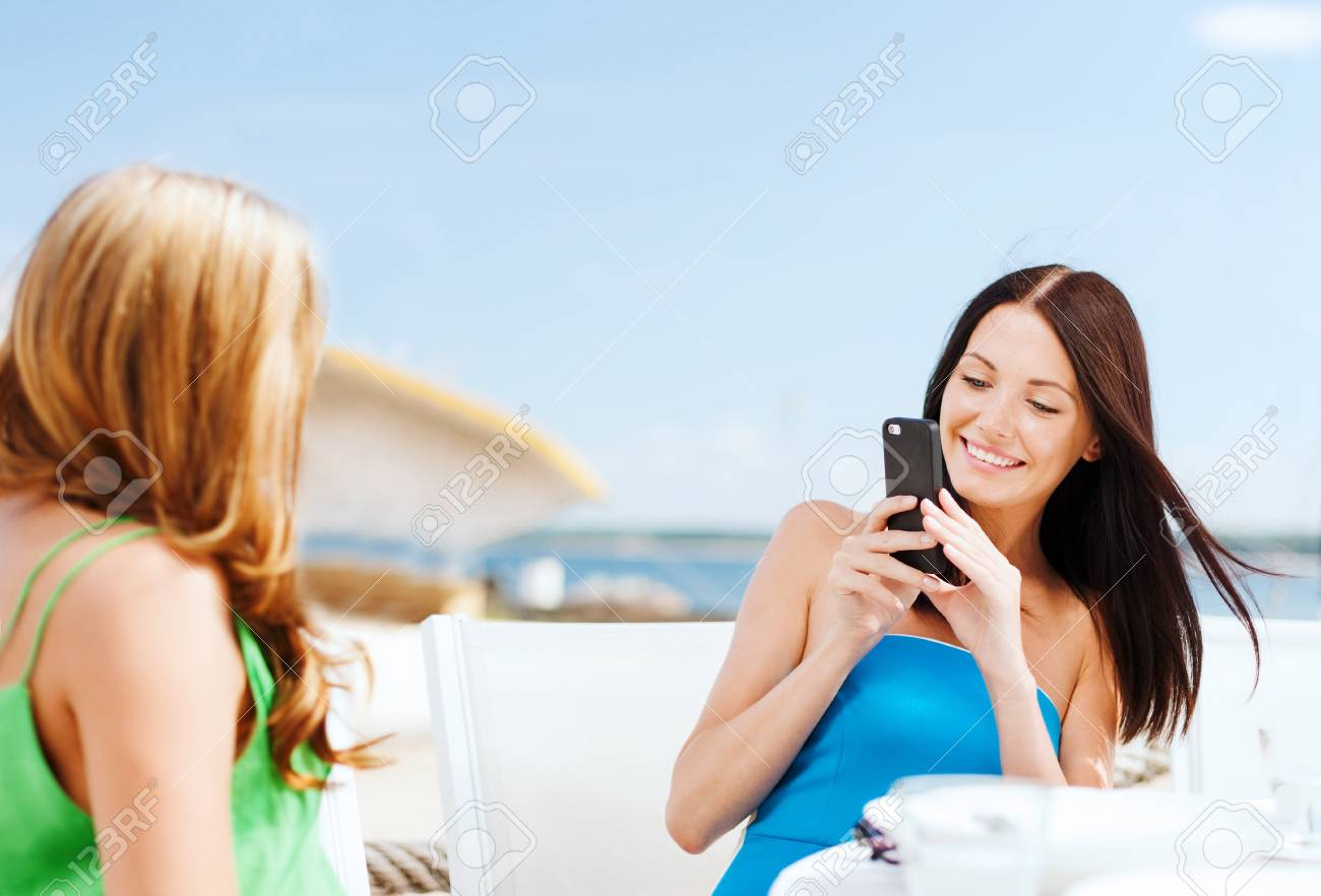 Summer Holidays Vacation And Technology Girls Taking Photo